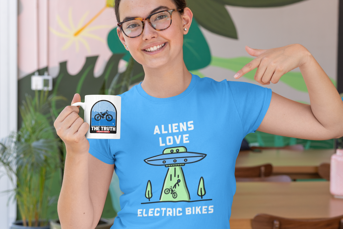 t-shirt-mockup-of-a-woman-with-glasses-pointing-at-an-11-oz-coffee-mug-29283.png