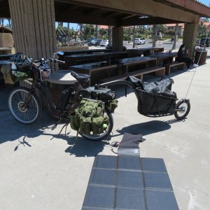 Fold out solar panel charging the ebike.jpg
